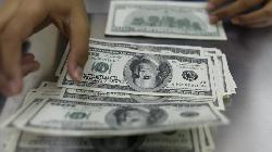 Dollar touches three-week high, lifted by recent data, Fed taper view