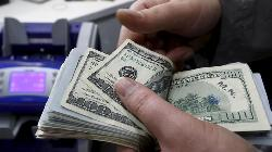 Dollar pares losses as Powell signals bond taper