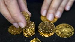 Gold Down, With Retreating U.S. Bond Yields Countering Strengthening Dollar