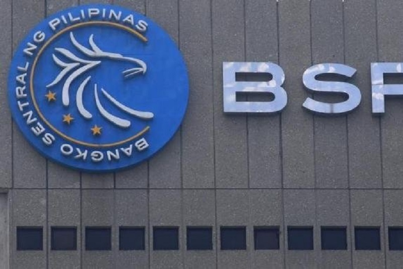 UPDATE 2-Philippine c.bank holds rates at record low, signals no change anytime soon
