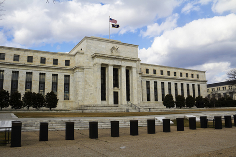 Federal Reserve ends zero rate policy, approving first hike since 2006
