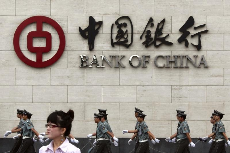Bank of China profit growth slowest in six years as bad loans jump