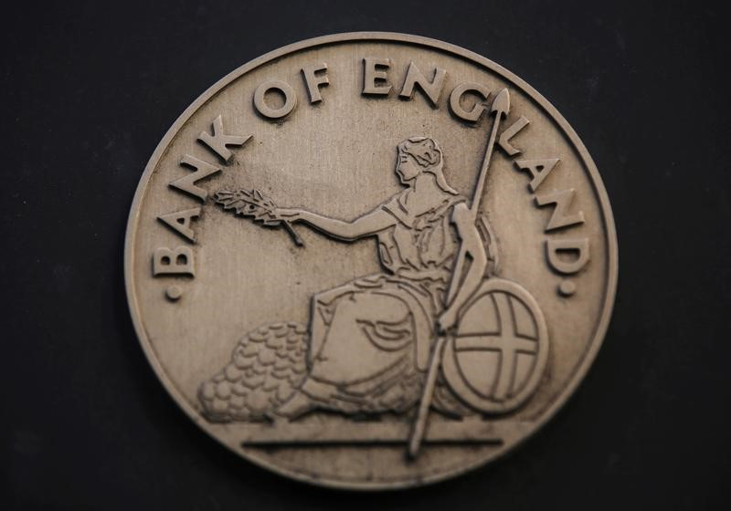 Bank of England to slow pace of asset purchases, interest rate unchanged