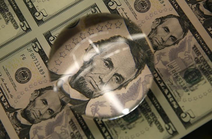 Dollar edges lower in thin trade, but remains supported