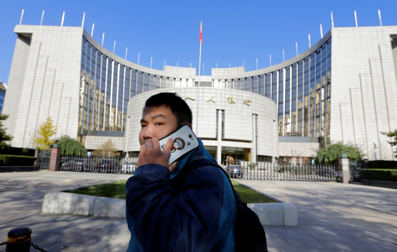 China's Central Bank Outlook Fuels Calls for Policy Easing