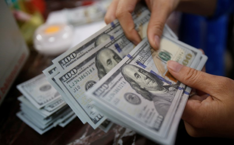 Dollar Up, Investors Await U.S. Inflation Trajectory