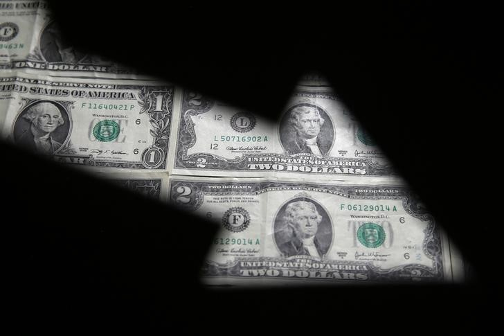 Dollar Edges Off One-Month High; Traders Digest Fed Statement