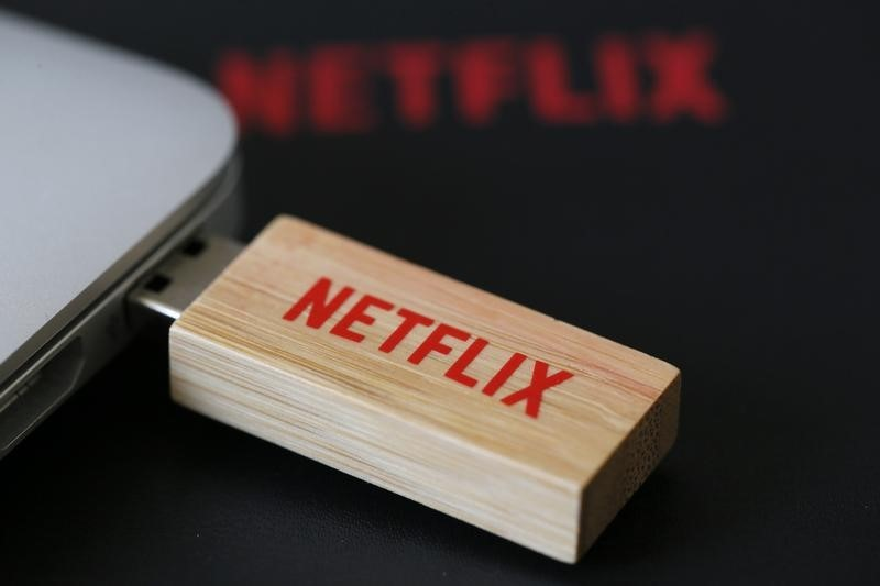 Netflix, Verizon Fall Premarket; Nasdaq Rises