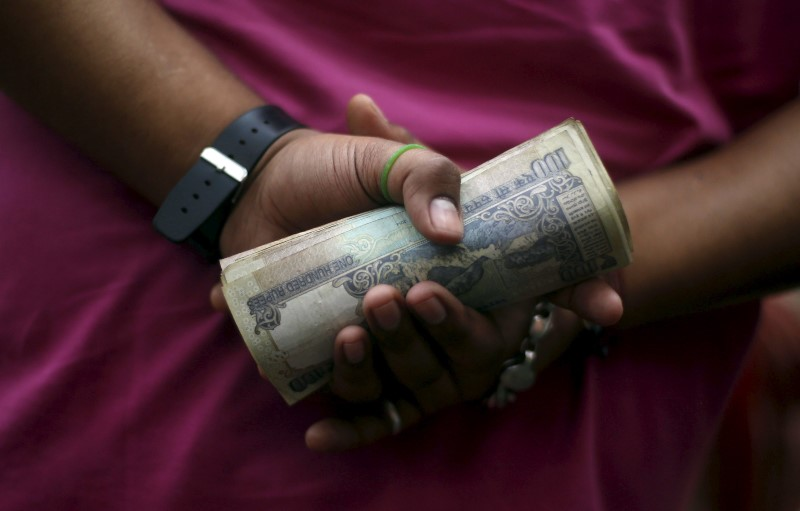 EMERGING MARKETS-Most Asian currencies flat, Indian markets hit by virus surge