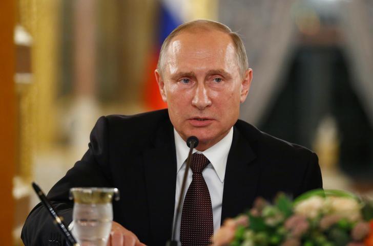 Путин повысил налог для богатых с13% до15%