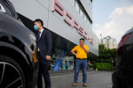 Unpaid by Evergrande, supplier sells Porsche and home to rescue his business