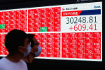 Asian shares stumble while the dollar holds firm