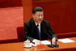 China's Xi vows 'reunification' with Taiwan, but holds off threatening force