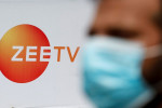 Why is Invesco entangled in a legal dispute with Indian TV giant Zee