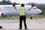 Asia's airlines ramp up flights, offers as tough COVID travel curbs ease