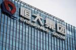 China developer shares slide as Evergrande concerns simmer