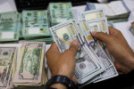 Dollar extends gains on Fed boost