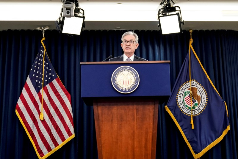 Fed's Powell keeps to script on jobs recovery, feels heat on inflation front