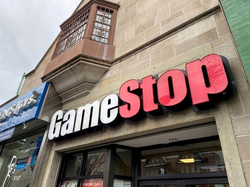 AMC, GameStop shares fall to half of their June peaks