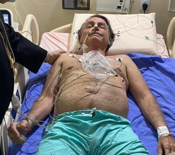 Brazil's Bolsonaro says he has improved, could leave hospital on Friday