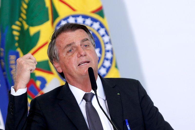 Brazil's Bolsonaro leaves hospital, says will be back at work Monday