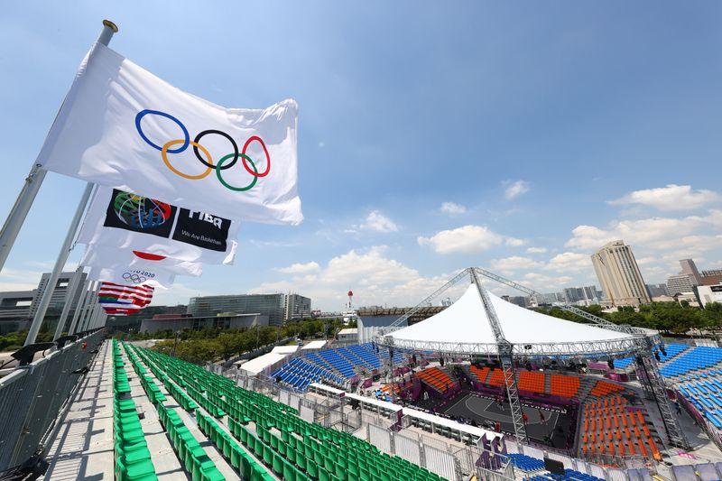 Olympics-Japan win softball opener as Games 'of hope' begin