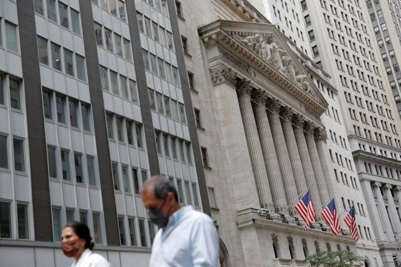 Wall Street ends higher, powered by strong earnings, economic cheer
