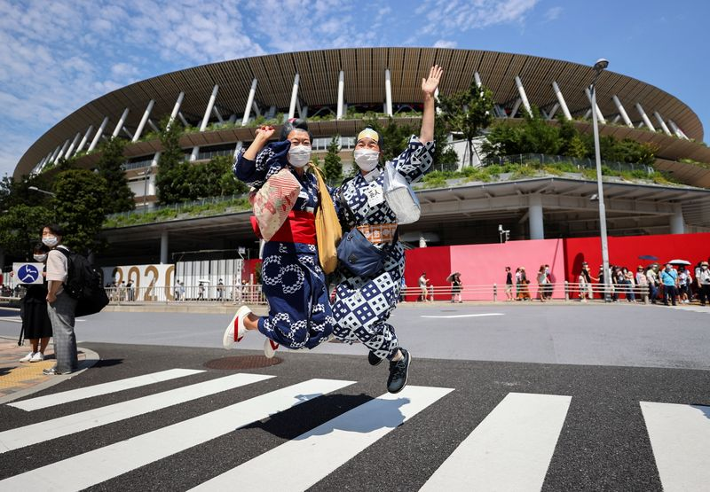 Olympics-Athletes parade in empty stadium as Tokyo Games open in shadow of pandemic
