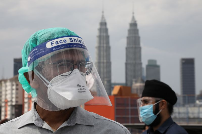 Southeast Asia's COVID-19 cases hit new highs, Malaysian doctors protest