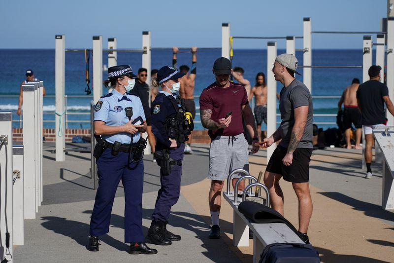 Sydney adds four weeks to lockdown as Australia COVID-19 cases grow