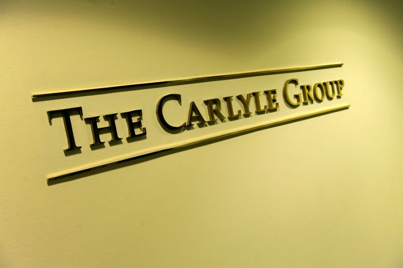 Carlyle's second-quarter earnings double on asset sales
