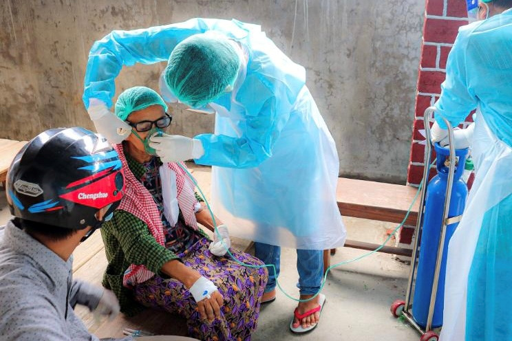 Britain warns COVID-19 could infect half Myanmar in next two weeks