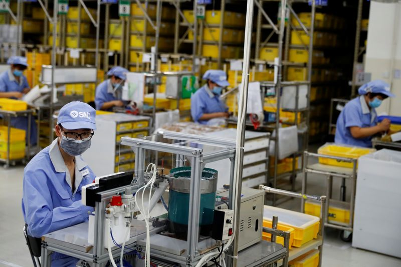 China July factory activity seen growing at a slightly slower pace: Reuters poll