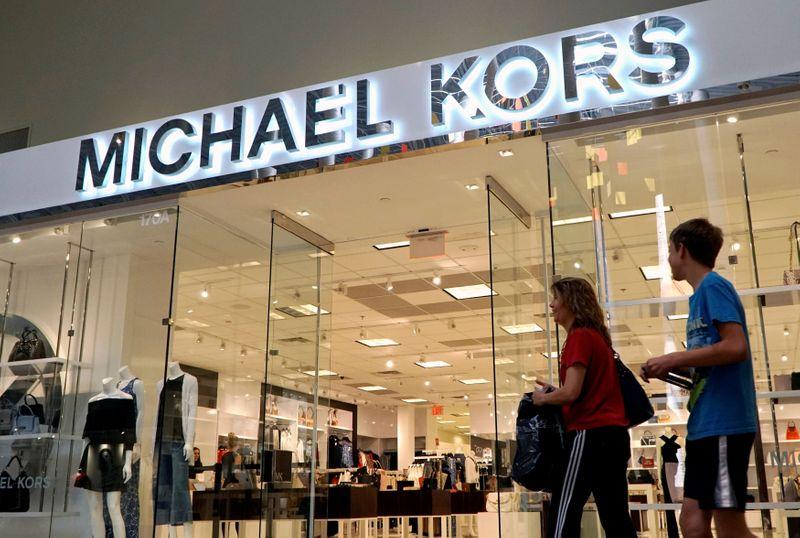 Michael Kors parent rides on post-lockdown splurge to lift forecasts