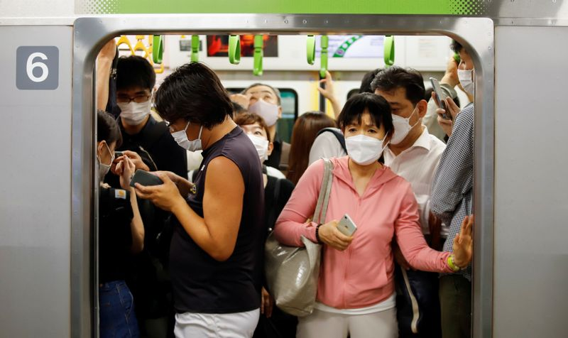 Flambée de coronavirus en Asie, records de contaminations à Tokyo