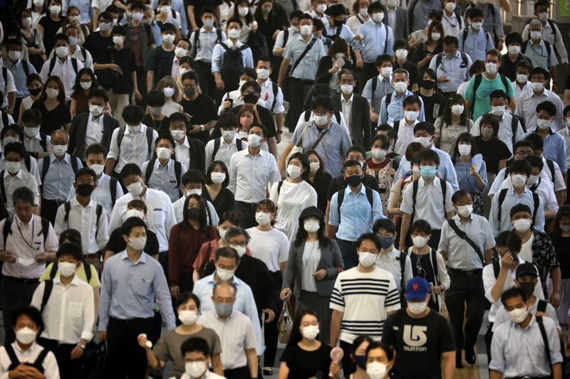 Japan warns of unprecedented COVID spread as cases hit record in Olympic host city