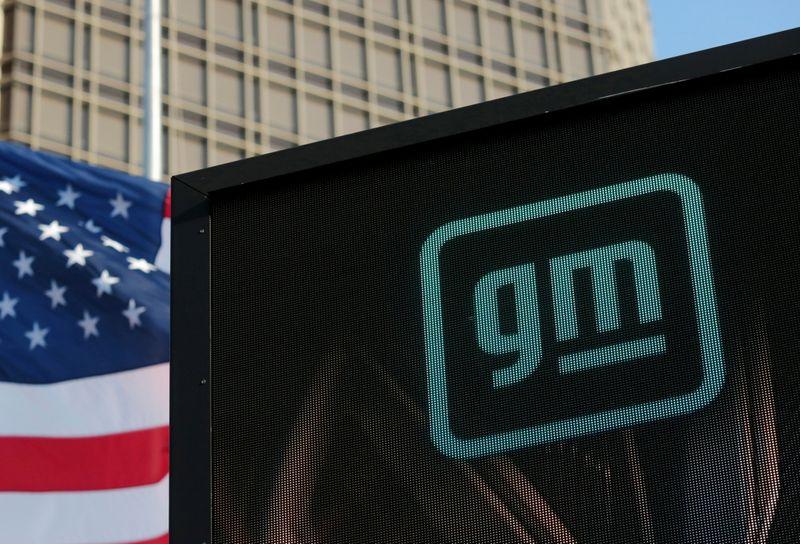 GM swings to profit, raises full-year outlook