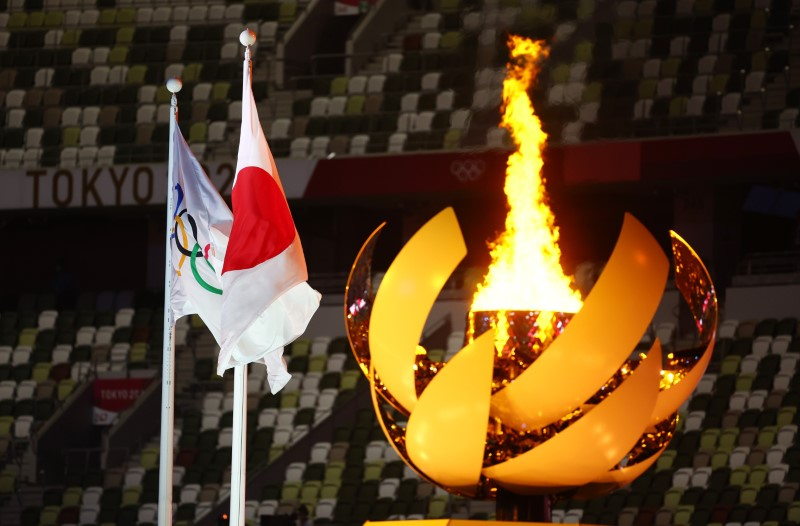 Japan to douse flame of Olympics transformed by pandemic and drama