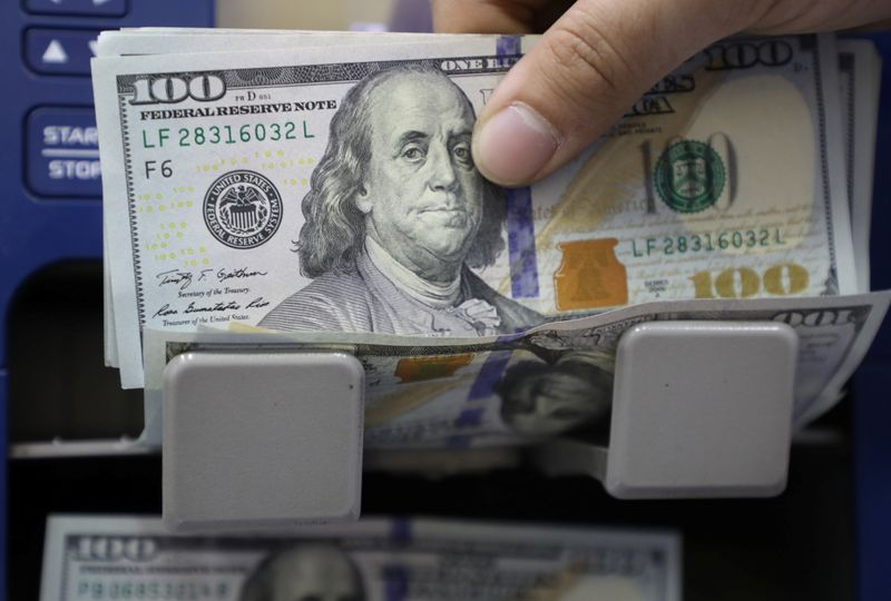 Dollar stands tall before Fed minutes; kiwi volatile
