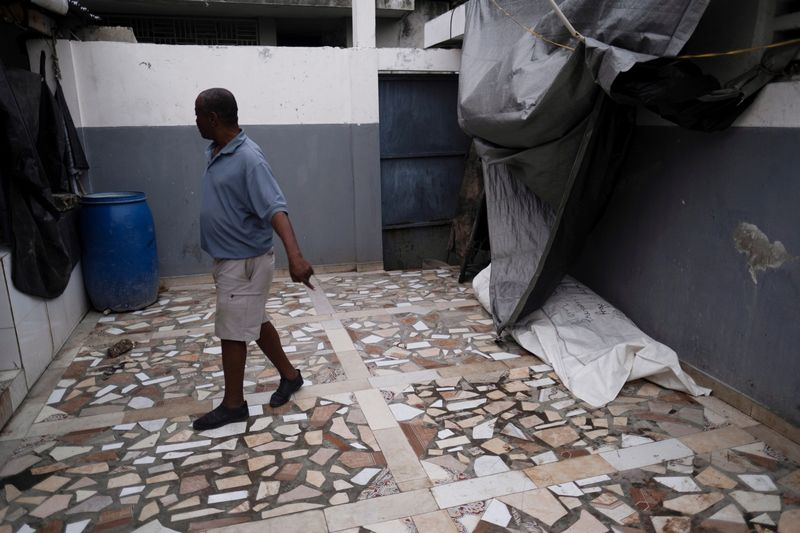 Morgues fill to capacity in Haitian town hard-hit by quake