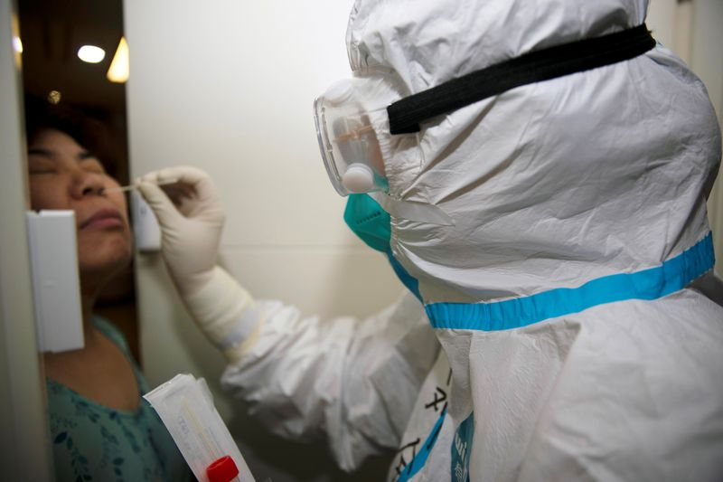 Shanghai places hundreds in quarantine after airport COVID-19 cases