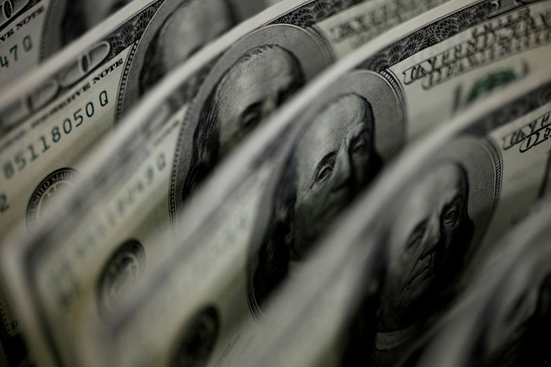 Dollar slips further as oil rallies, commodity currencies gain