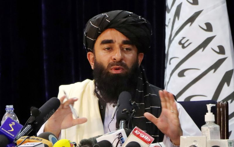 'Don't panic and get back to work', Taliban order former officials