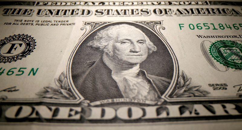 Dollar trades flat as U.S. yields rise, oil advances