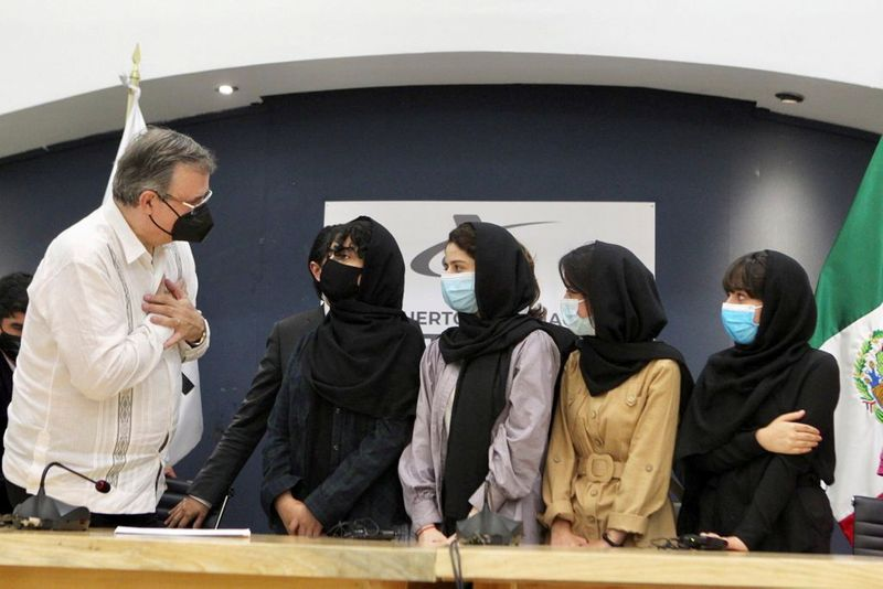 Afghan all-girl robotics team members, journalists land in Mexico
