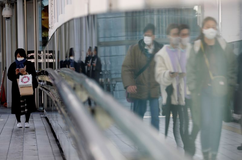 Japan keeps economic view intact, bleaker on outlook due to COVID