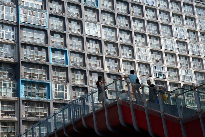 Growth in China's home prices set to slow in 2021 on policy curbs: Reuters poll