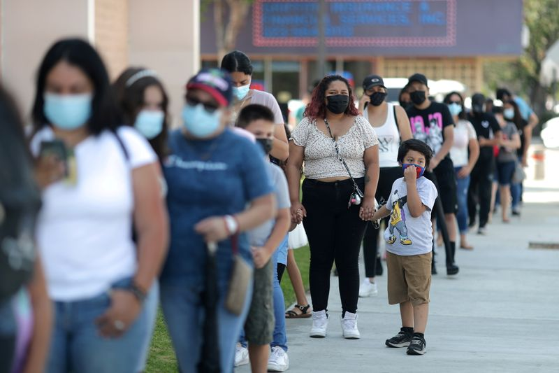 U.S. COVID-19 tests again in short supply as infections soar, schools reopen