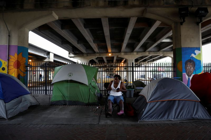 New Orleans homeless shelters scramble to bring in residents, facing storm and Covid surge