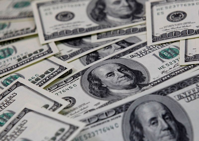 Dollar holds near two-week lows in Fed's wake